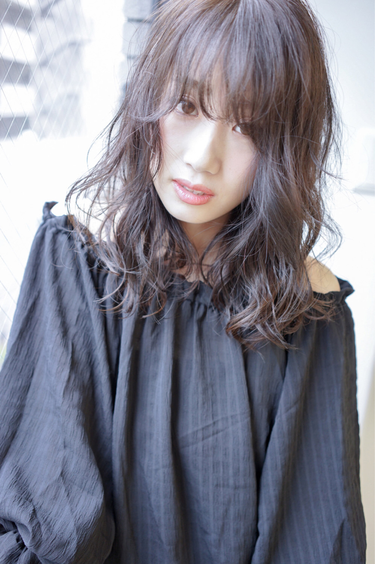 外国人風 アンニュイ 外国人風カラー ウェーブヘアスタイルや髪型の写真・画像